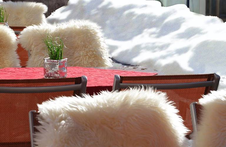 Table with fur-covered chairs