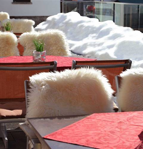 Tables and chairs with fur cover