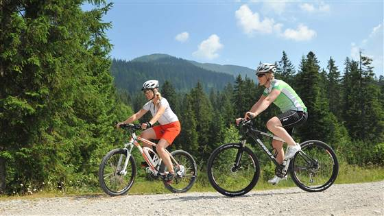Couple mountain biking