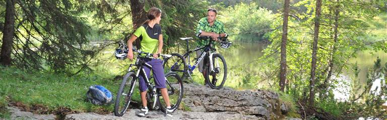 Couple takes a break at mountain biking