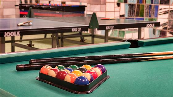 Billiard table with balls and cue